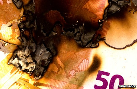 Burning euro notes