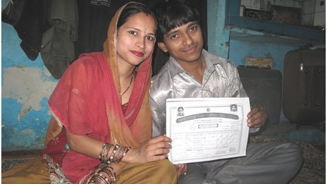 Rajveer Singh and his wife Madhuri with their marriage licence