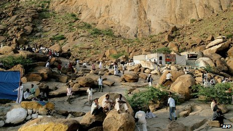Sudanese men sit on granite rocks in the centre of the eastern Sudanese town of Kassala on February 17, 2010. 