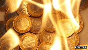 one euro coins in flames