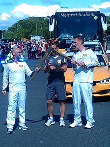 Rob Jackson receives the flame from Joe Shaw