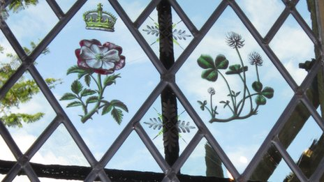 Stained glass window featuring flowers