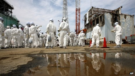 People in protective suits at Fukushima