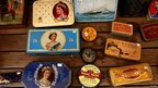Antique tins depicting Queen Elizabeth are for sale in a shop in Portobello Market in west London