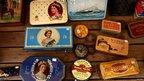 Antique tins depicting Queen Elizabeth are for sale in a shop in Portobello Market in west London