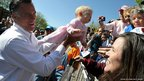 Republican presidential candidate Mitt Romney holds a baby as he greets supporters during a campaign rally at Alice Pleasant Park in Craig, Colorado.