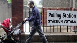 A man with a buggy passes a polling station in Drumcondra, Dublin, 31 May