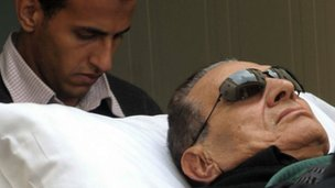 A picture taken on January 5, 2012 shows ousted Egyptian president Hosni Mubarak being wheeled on a stretcher into a court for his trial in Cairo on January 5, 2012.