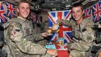Trooper Lewis McCormick 19, from Oldham (l) and Lt Cpl Thomas Constant, 24, from Bournemouth, both of the King's Royal Hussars, enjoyed an impromptu Diamond Jubilee tea party in Helmand Province