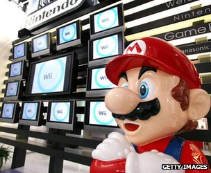 Mario model stands in front of Wii display