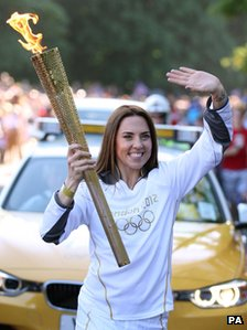 Melanie C carries the Olympic flame