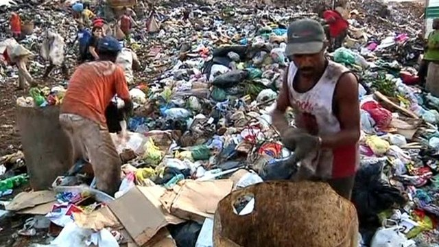 Workers on landfill site