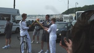 Tom Black giving torch to Cai Beynon