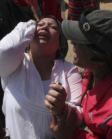 Supporters of Mubarak react to the court verdict