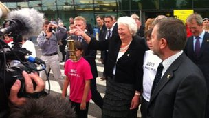 Mary Peters with the Olympic flame