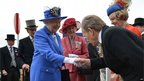 The Queen shaking hands with a racegoer