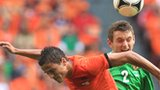 Netherlands midfielder Ibrahim Afellay is beaten to the high ball by Lee Hodson