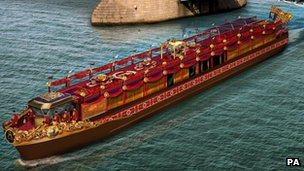Artist's impression of the royal barge by Tower Bridge in London
