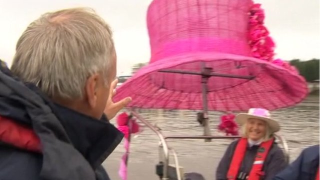 Large pink hat on boat