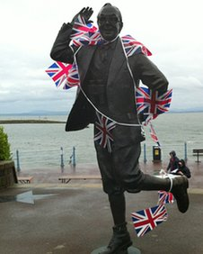 Statue of Eric Morecambe covered in Union Flag bunting