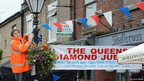 Organisers start to dress the shops prior to the Jubilee street party in Marple Bridge, Stockport in Manchester