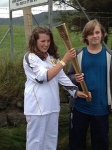 Amanda Wilson takes her turn wit the Olympic torch