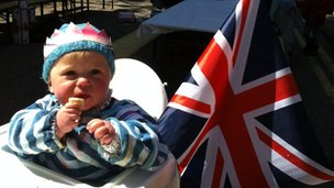 Baby with flag - pic by James Cook