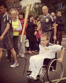 Daniel Black with the torch