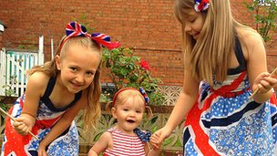 Three girls in Wolverhampton with flags