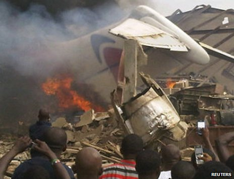 The wreckage of a plane burns in Nigeria's commercial capital Lagos after it crashed into a residential district on Sunday