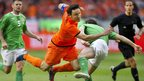 Mark van Bommel takes a tumble after a strong challenge from Northern Ireland defender Michael Duff