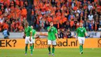 A familiar sight - dejected Northern Ireland players trudging back for the restart after a Netherlands goal