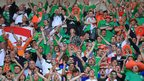 Northern Ireland's travelling fans show their support for the team despite the score