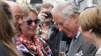 Prince Charles, Prince of Wales chats with people at a street party