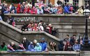 People wait for the start of the pageant along the River Thames 