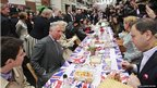 Prince Charles, Prince of Wales and Camilla, Duchess of Cornwall sit and a chat with some of those taking lunch in Piccadilly