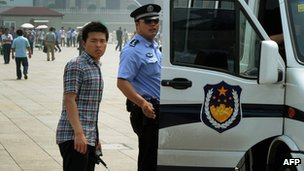 Police detain a man (R) in Tiananmen Square on the 23rd anniversary of China's crackdown of democracy protests, in Beijing on 4 June 2012