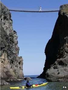 Clare Leahy crosses the Carrick-a-Rede rope bridge
