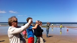 Spectators wait for the torch on Downhill Beach