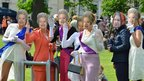 Ladies with Queen masks taking part in celebrations in Perth