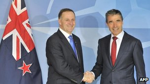 Nato Secretary General Anders Fogh Rasmunsen, right, shakes hands with Prime Minister of New Zealand John Key on 4 June, 2012