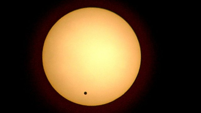 The planet Venus crosses the face of the Sun