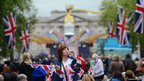 Royal supporters gather on the Mall outside Buckingham Palace in London