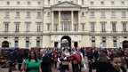 Ticket-holders enter the grounds of Buckingham Palace