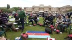 A group of injured British war veterans connected with the charity Help for Heroes, along with some 10,000 people, enjoy a special picnic in the grounds of Buckingham Palace
