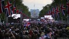 A large crowd fills The Mall in front of Buckingham Palace to watch The Diamond Jubilee Concert on big screens