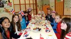 Girls sitting down for Jubilee-themed tea party