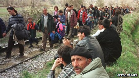 Ethnic Albanians flee Kosovo in 1999