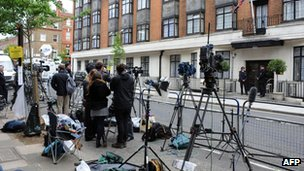 Journalists and cameramen stand outside the King Edward VII