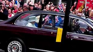 Queen Elizabeth II in a convoy on the way to St Paul's Cathedral